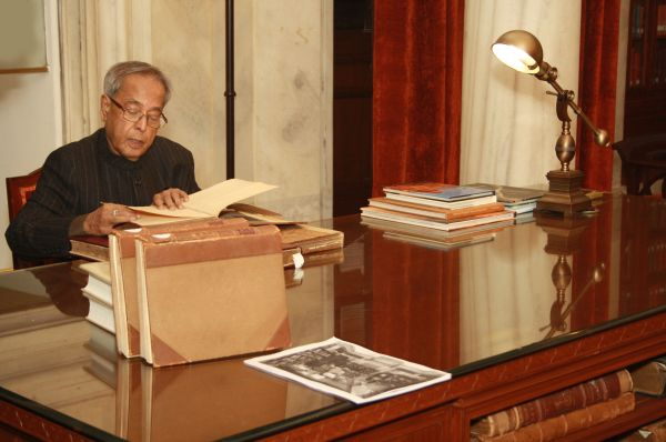 Pranab Mukherjee checks out old volumes in the library